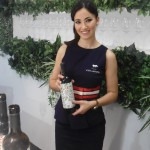 Best Design at Fenavin?! Miss Spain decants wine for the press, beautifully!
